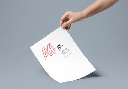 Handheld A4 PSD Paper Mockup