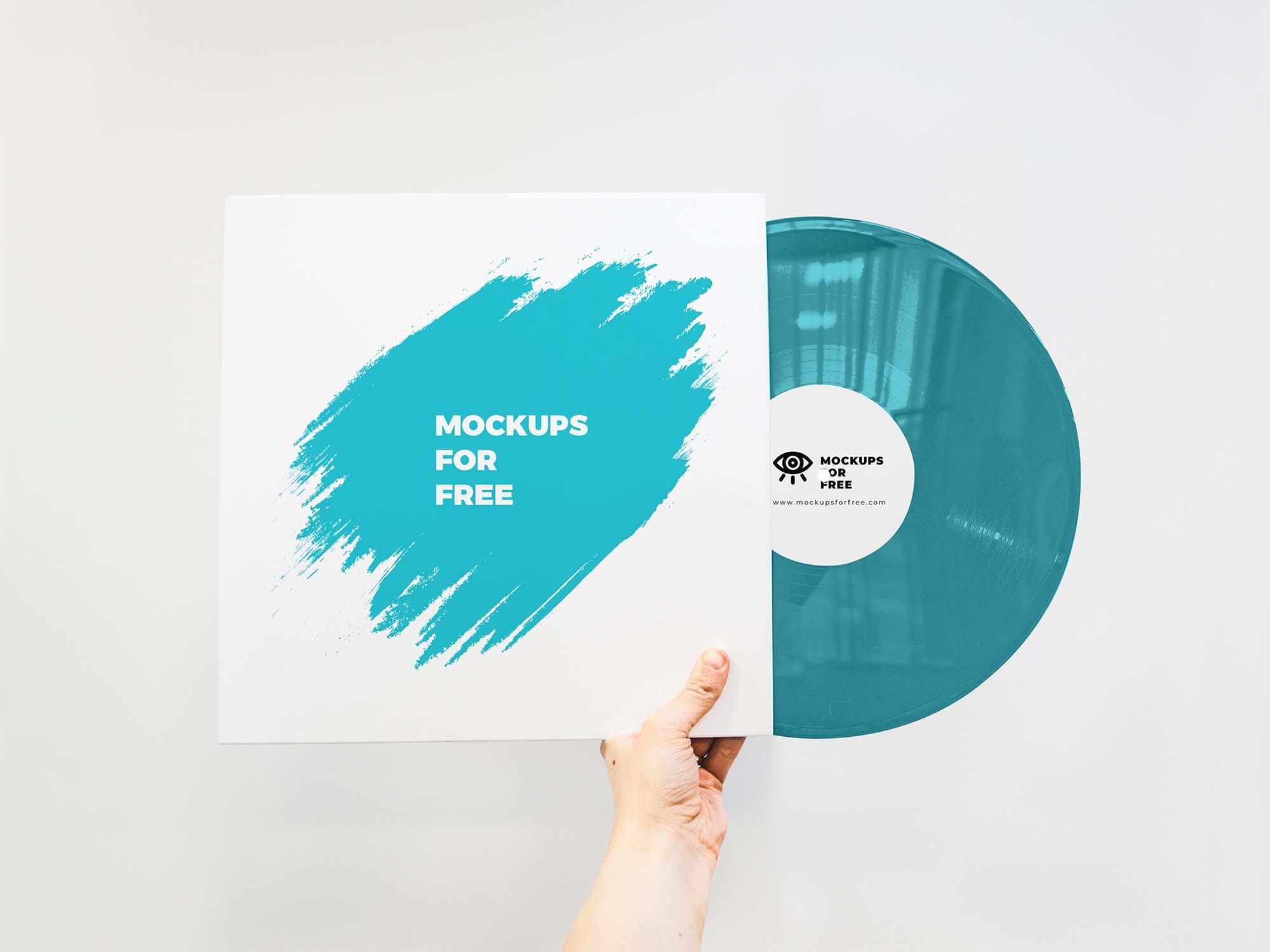 Vinyl Record In Hand Mockup