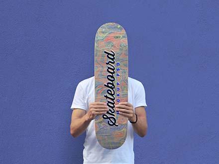 Man Holding Skateboard Mockup