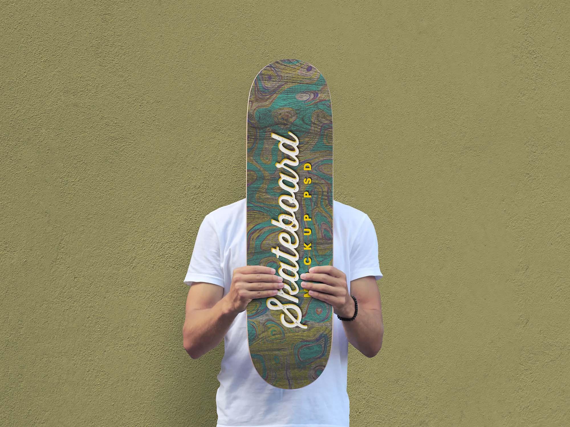 Man Holding Skateboard Mockup 2