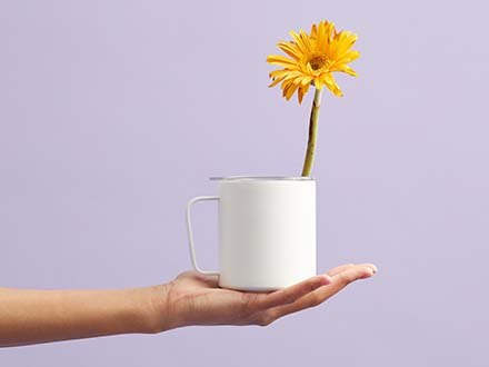 Mug in Hand Mockup