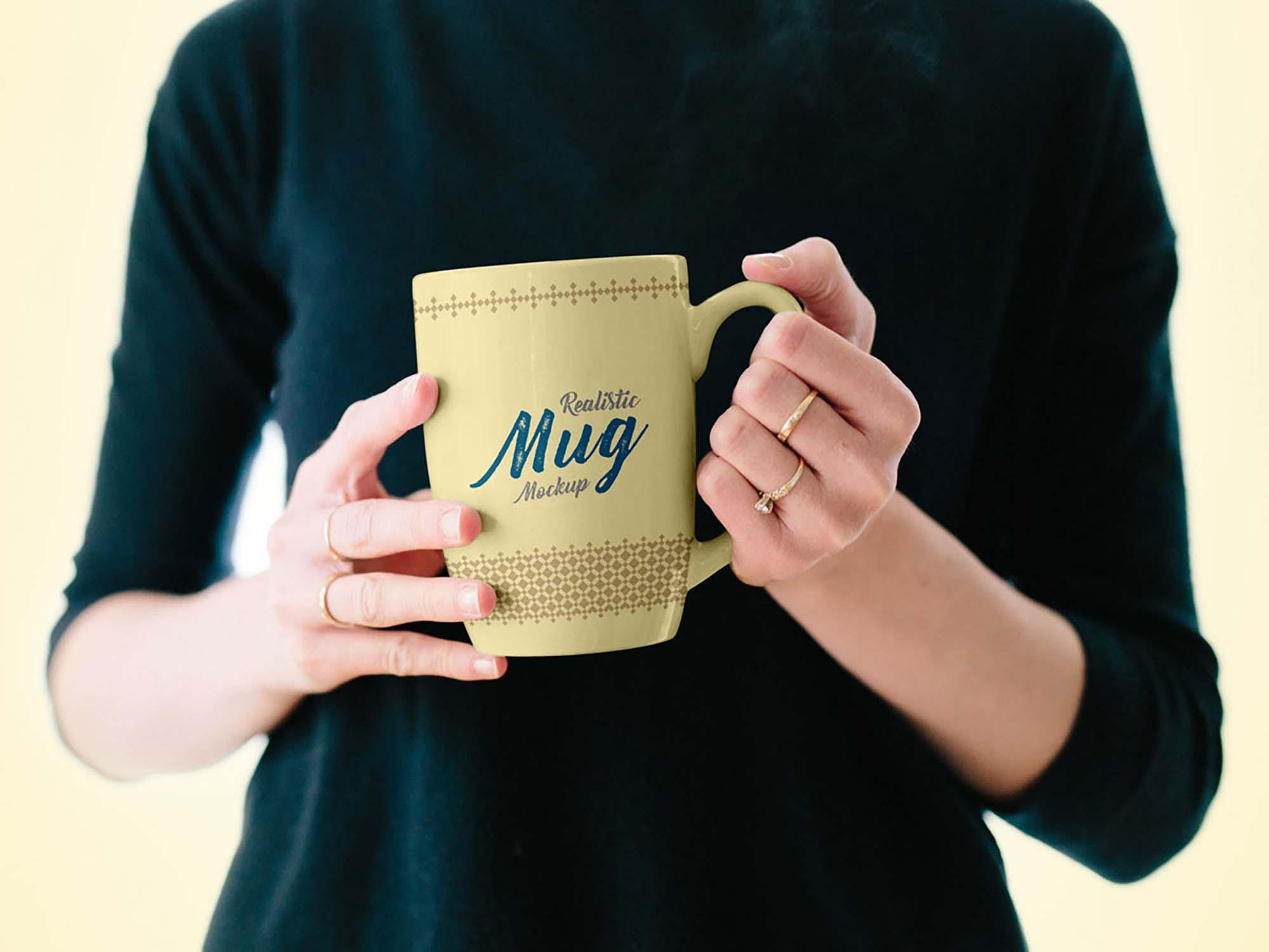Mug in Female Hand Mockup