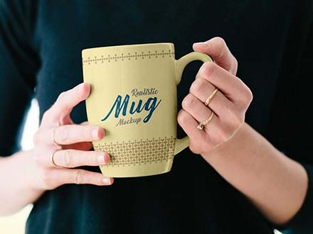 Mug in Female Hand Mockup