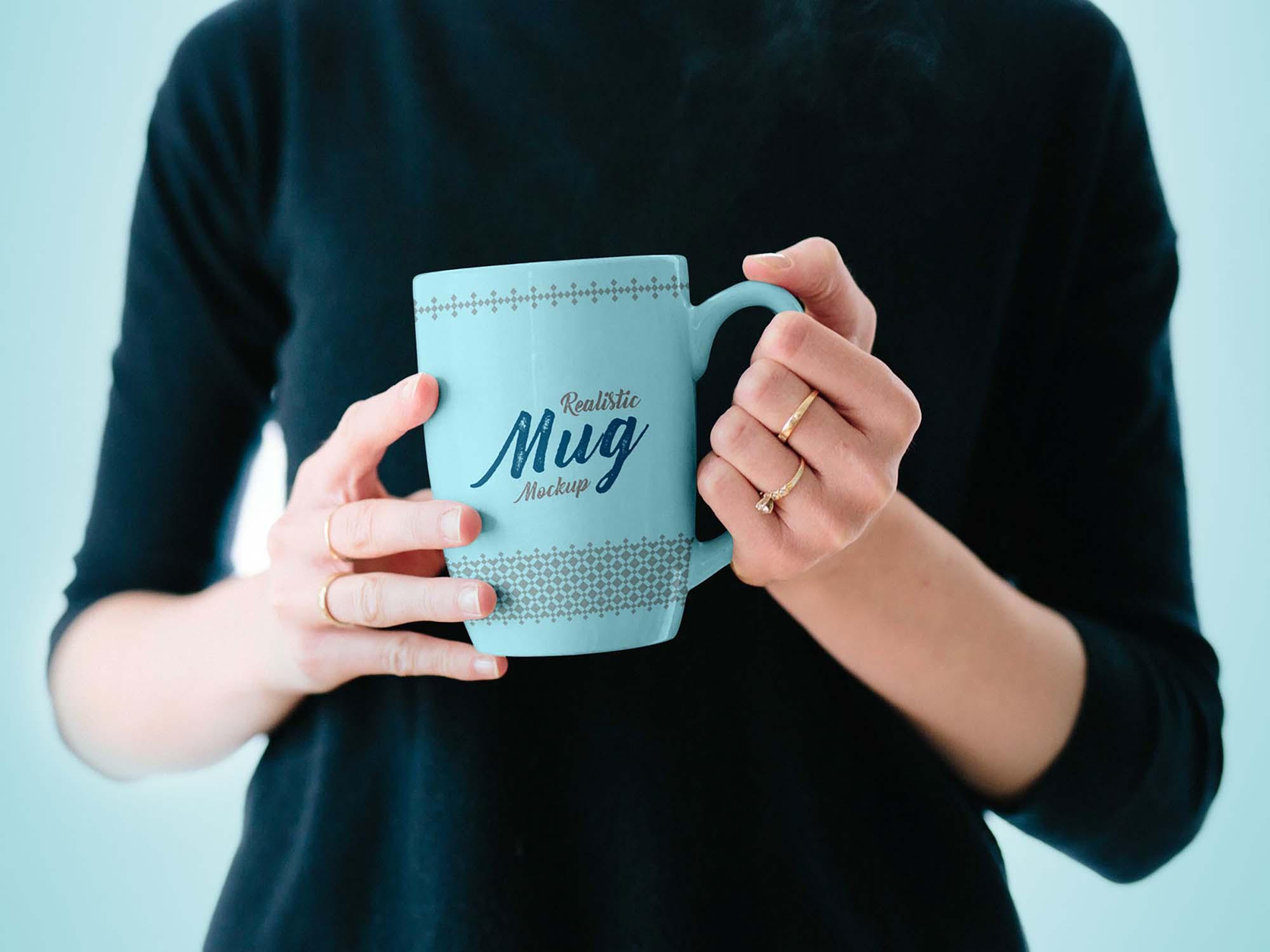 Mug in Female Hand Mockup 2