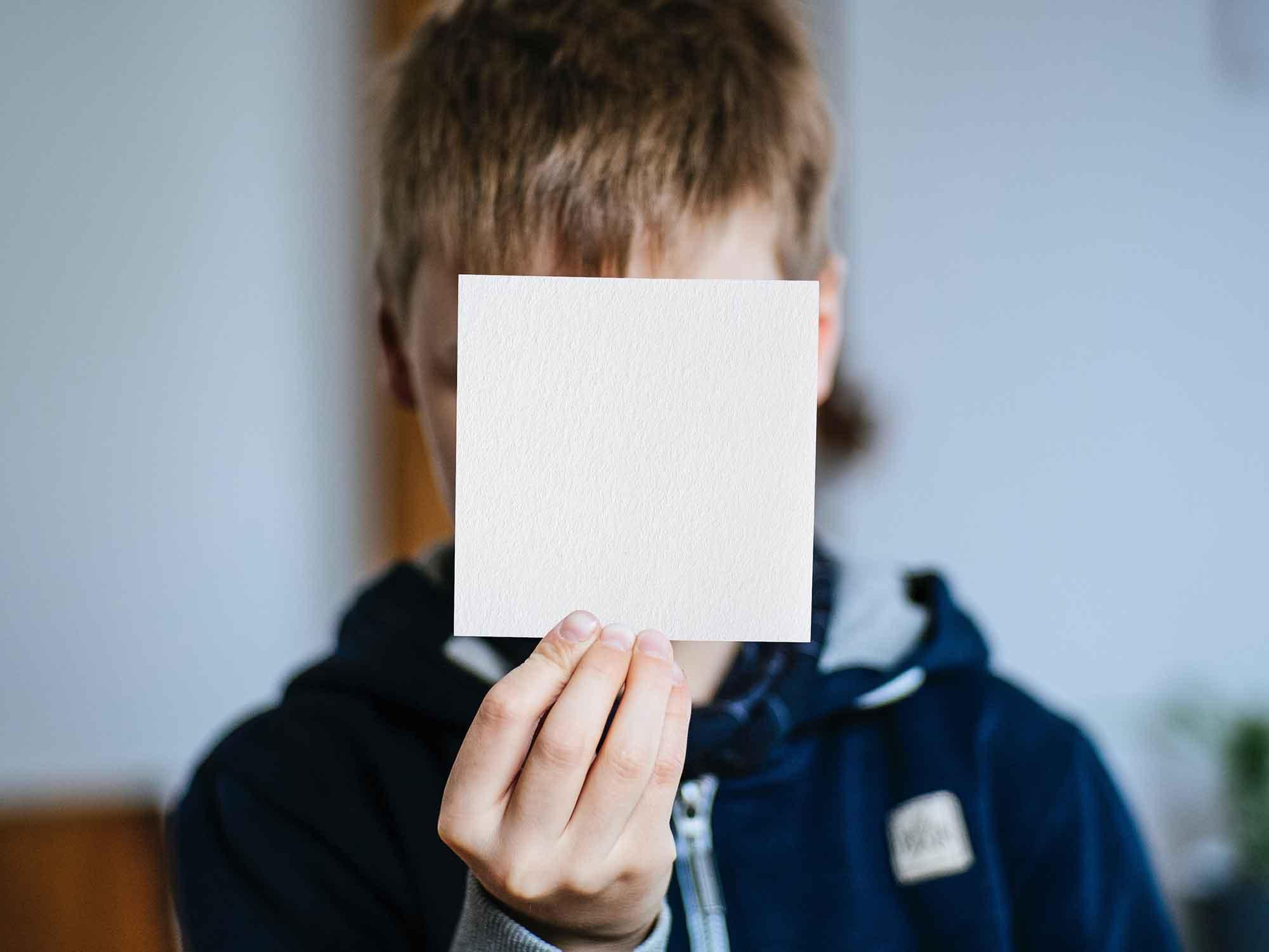 Boy Showing Square Card Mockup 2