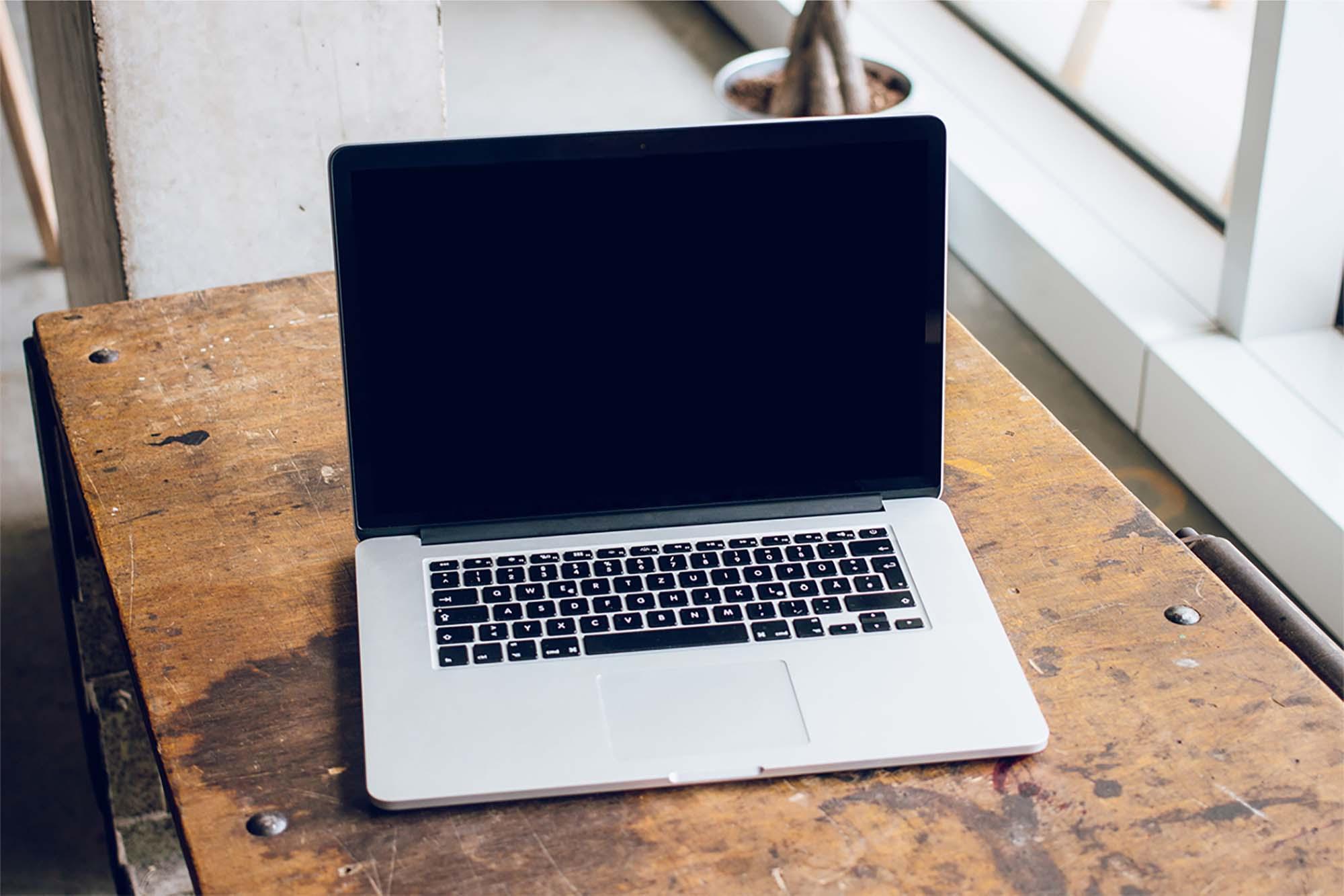 MacBook Pro on Table Mockup 2