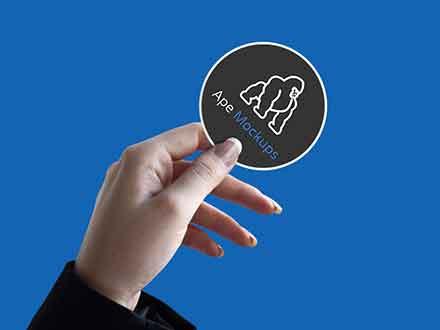 Sticker in Hand Mockup