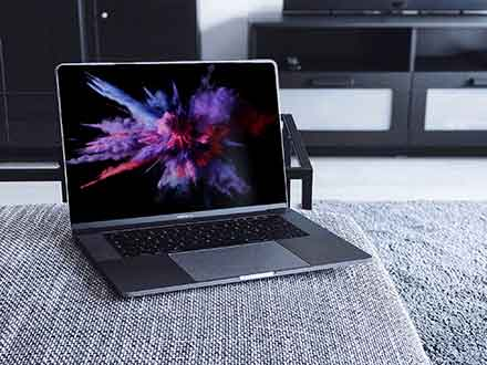 MacBook Pro on Couch Mockup