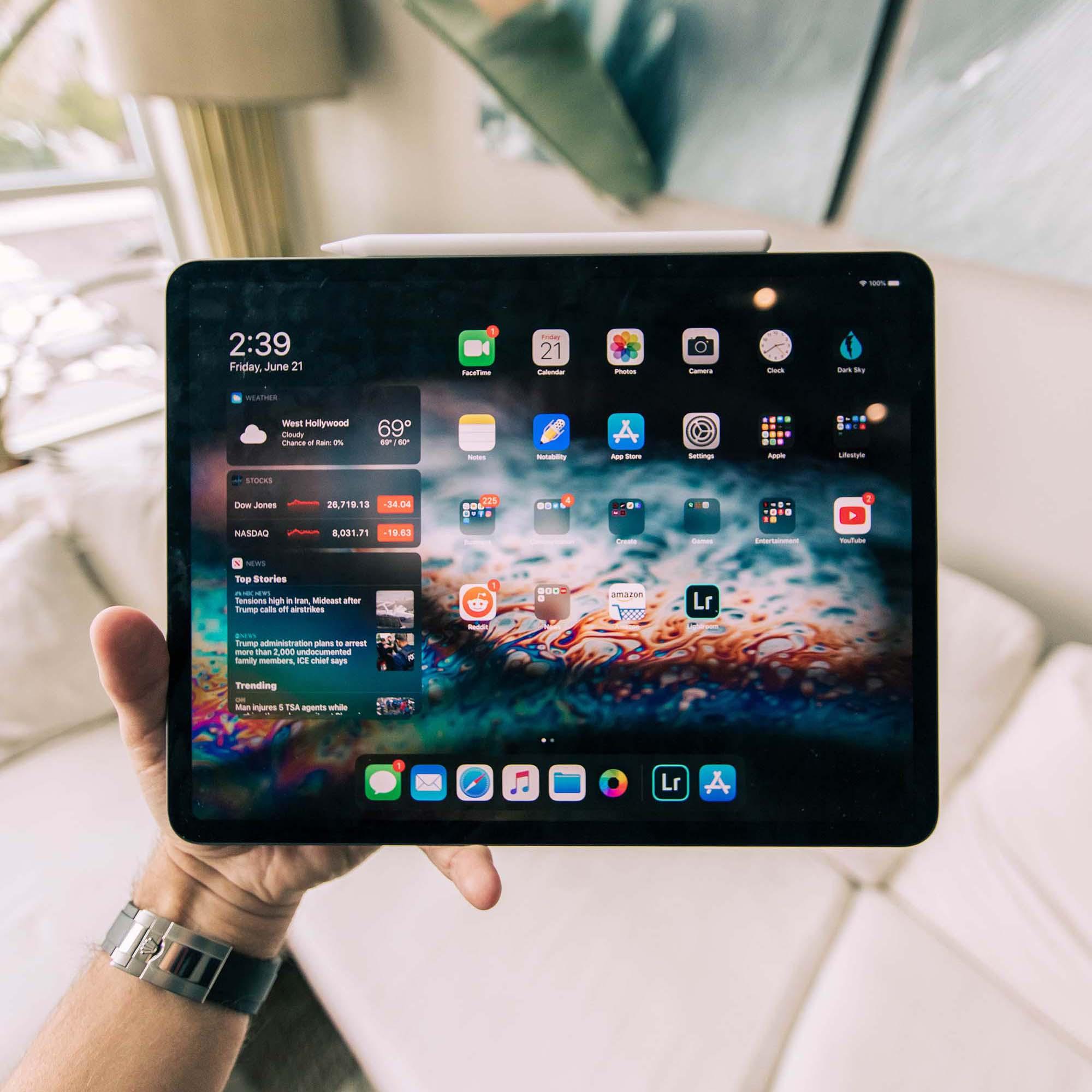 Tablet in Hand Mockup