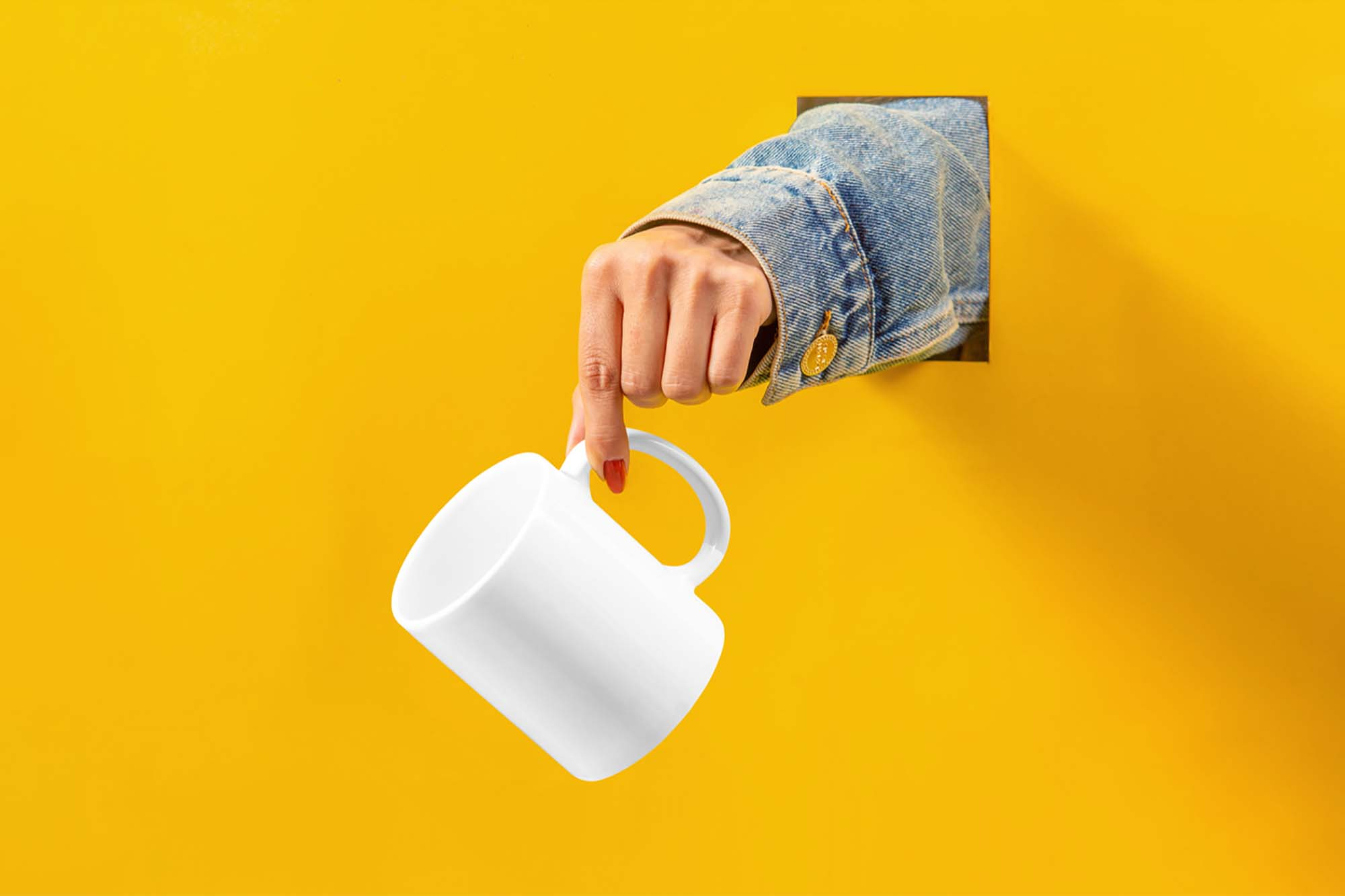 Cup with Hand Mockup 2