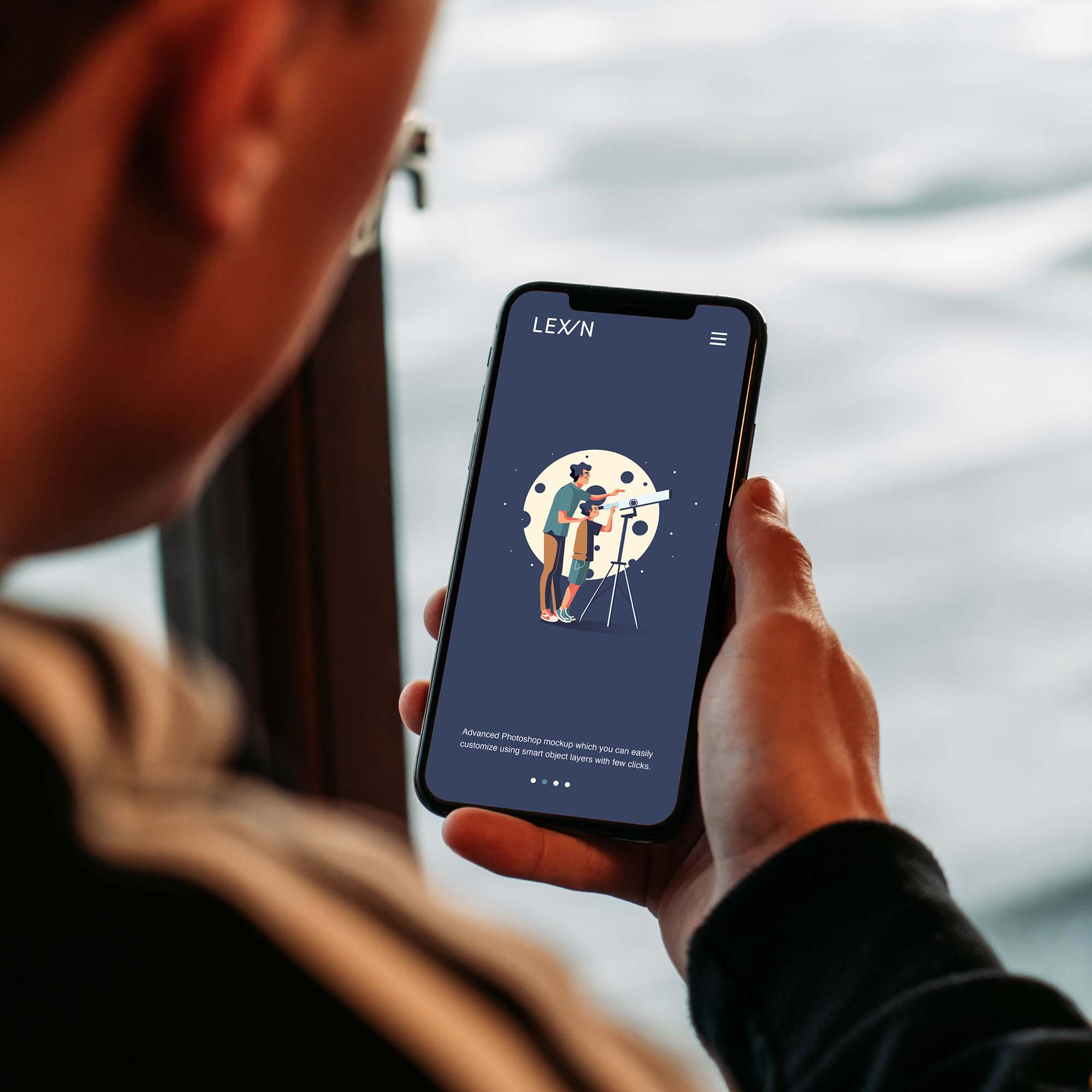Man Holding iPhone Mockup