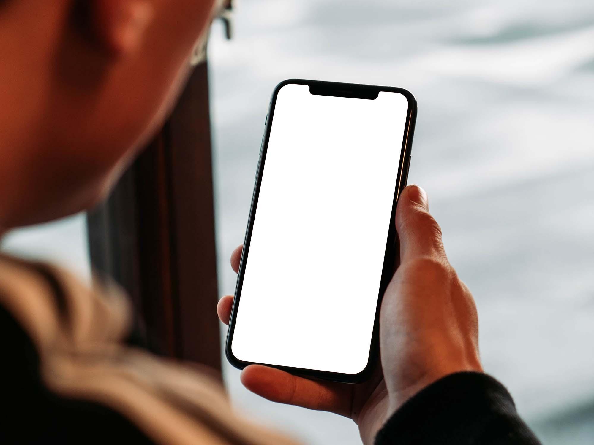 Man Holding iPhone Mockup 2