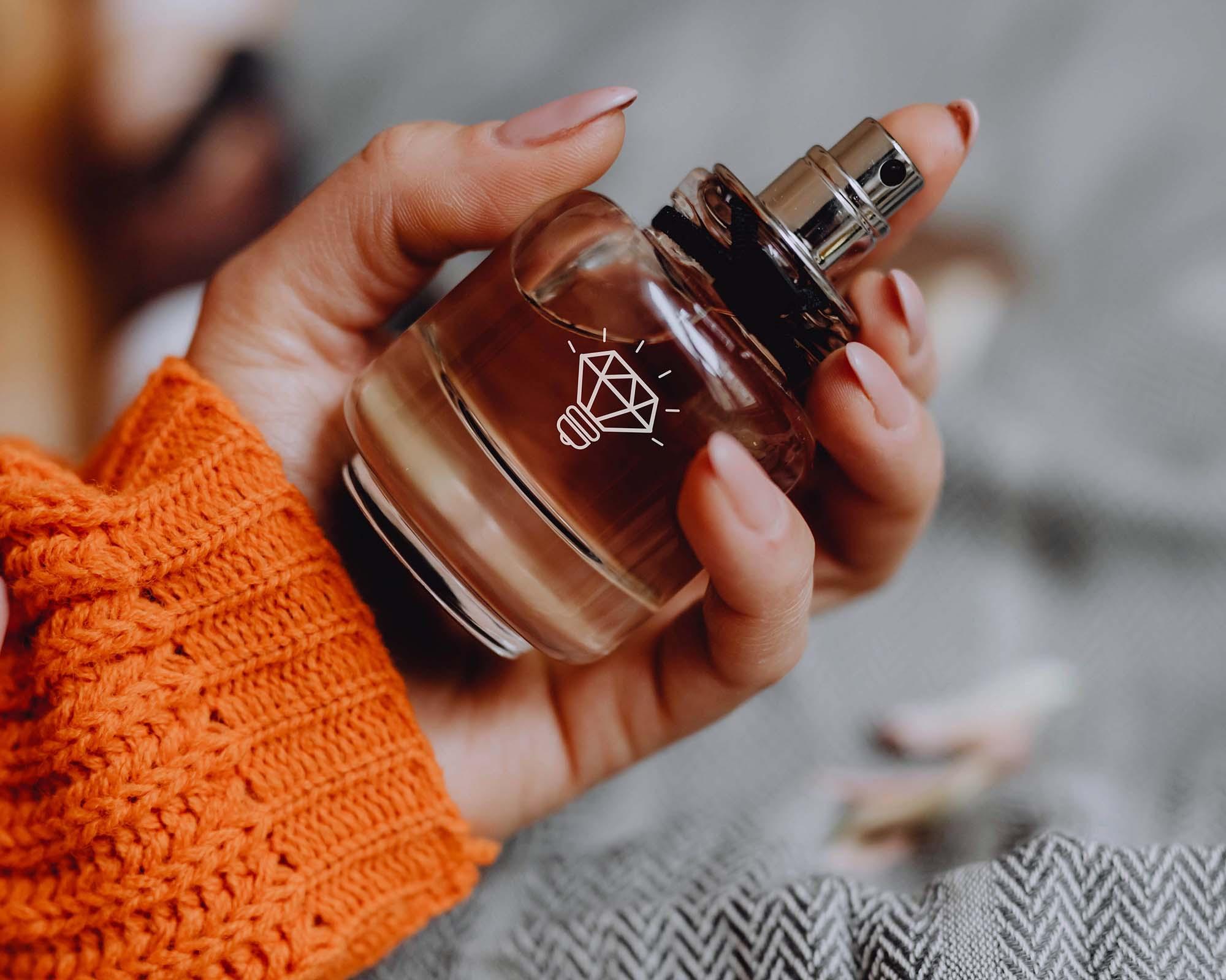 Perfume Held by a Hand Mockup
