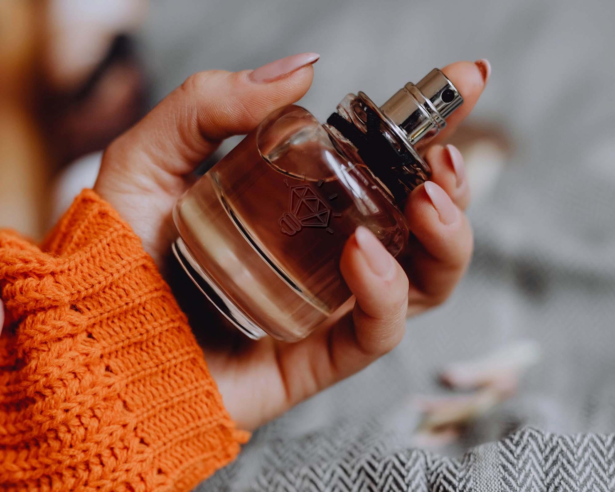 Perfume Held by a Hand Mockup 2