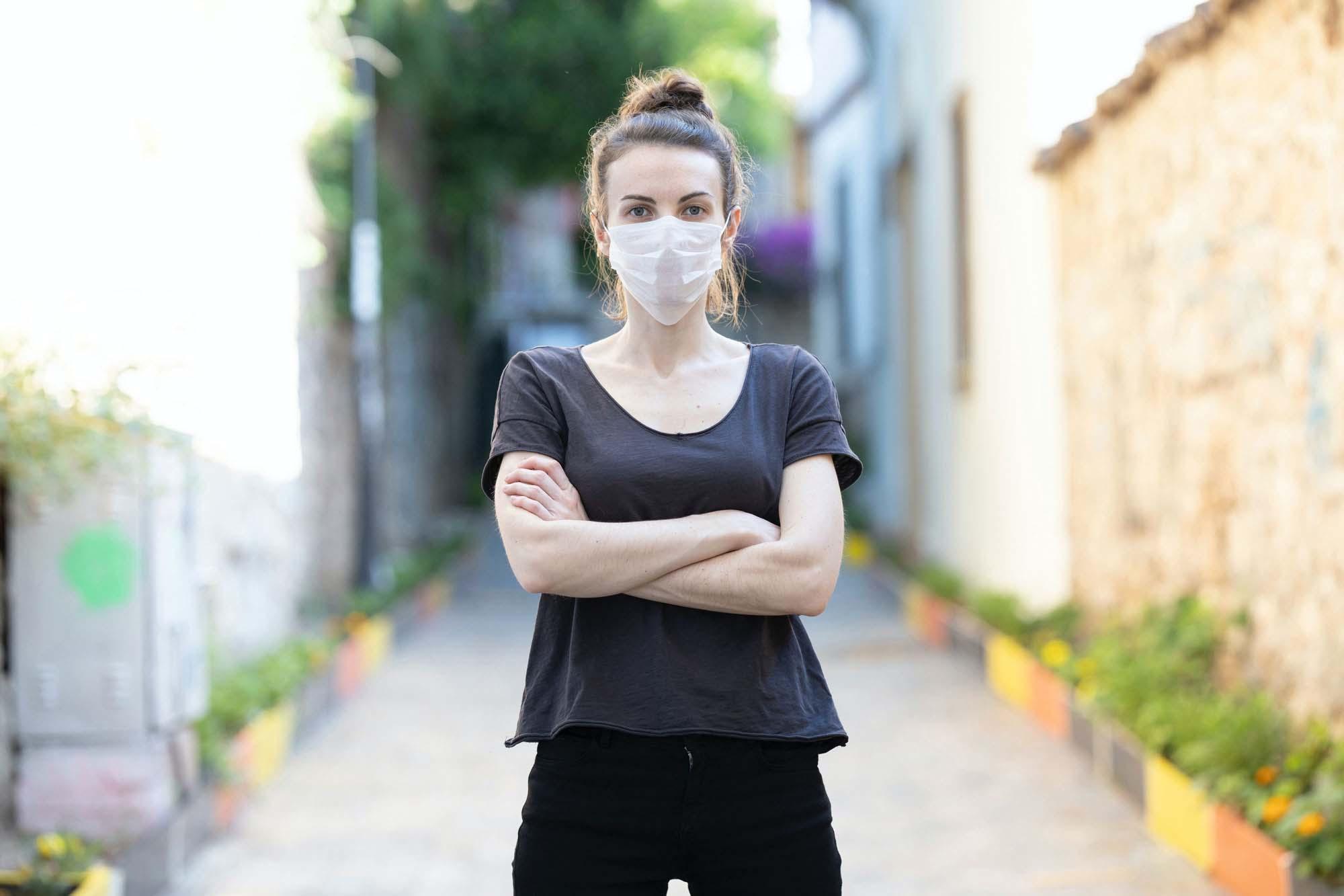Woman Wearing a Face Mask Mockup 2