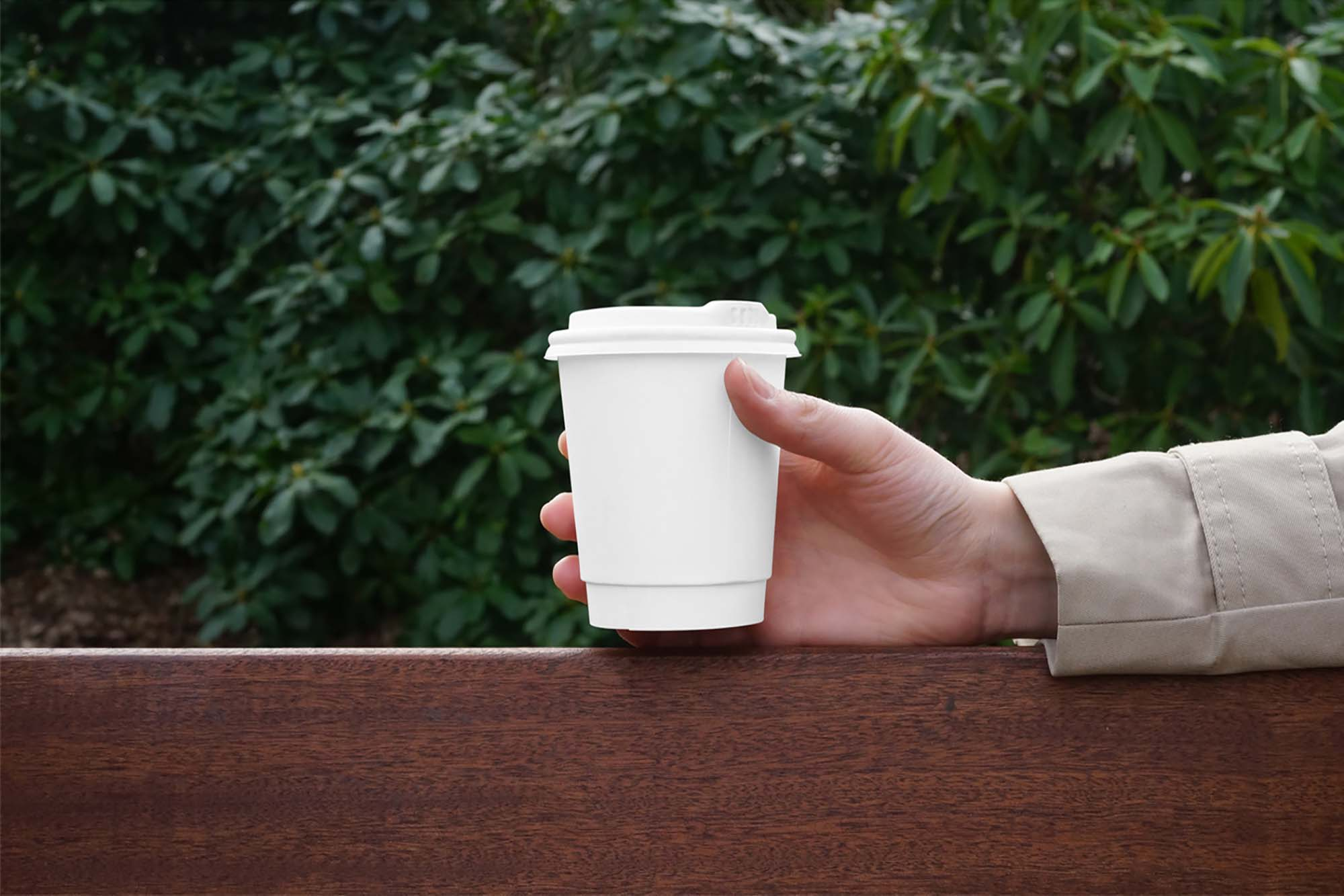 Hand Holding Coffee Cup Mockup 2