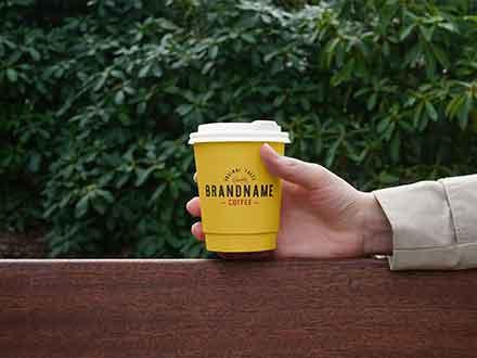 Hand Holding Coffee Cup Mockup