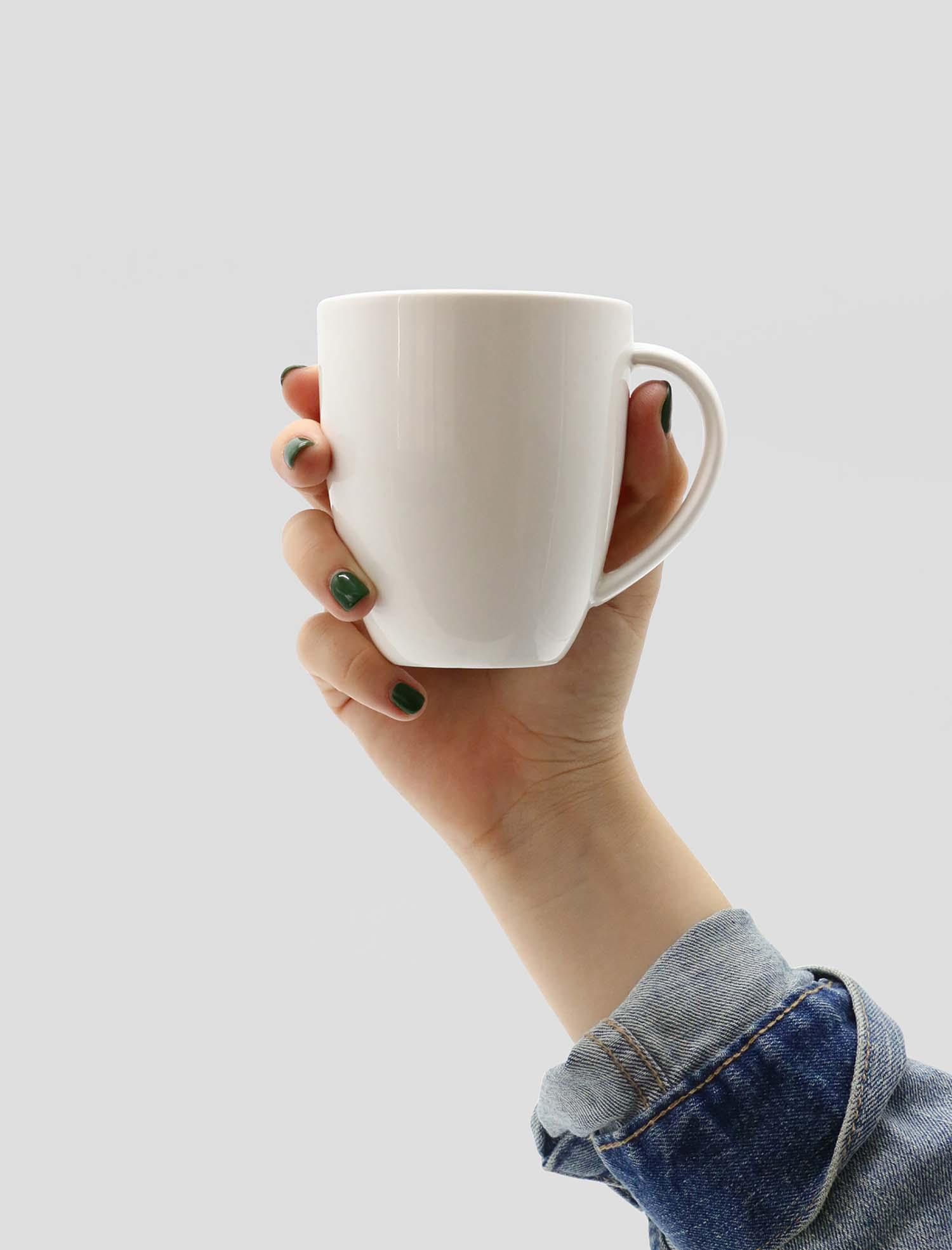 Hand Holding Mug Mockup 2