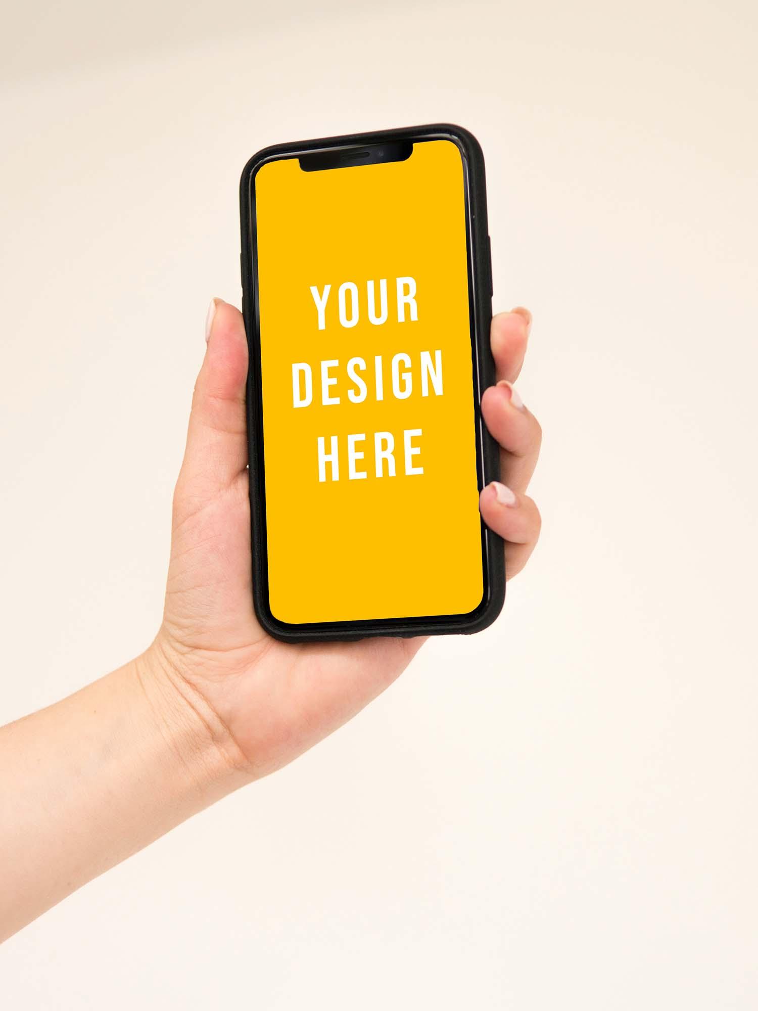 iPhone Held in Hand Mockup
