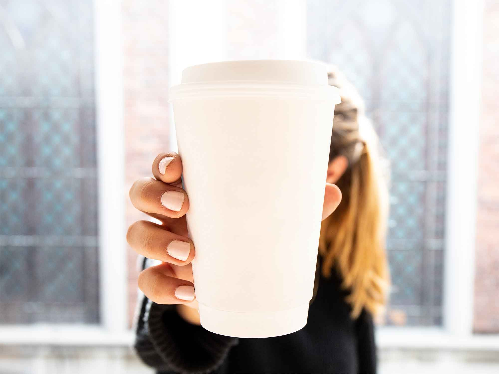 Woman Holding Cup Mockup 2